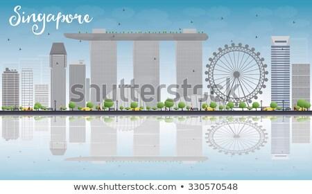 Singapore skyline with grey landmarks and blue sky. Stock photo © ShustrikS