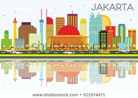 Jakarta Skyline with Color Buildings, Blue Sky and Reflections. Stock photo © ShustrikS