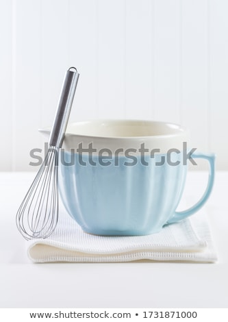 Blue mixing bowl with wisp for baking on white background Stock photo © brebca