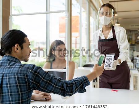 Asian waitress serving food new normal. Stock photo © vichie81