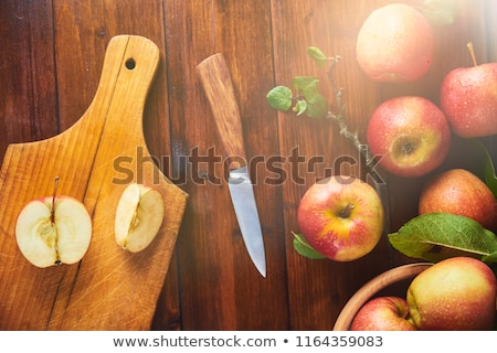 half apple and knife on wooden cutting board Stock photo © dolgachov