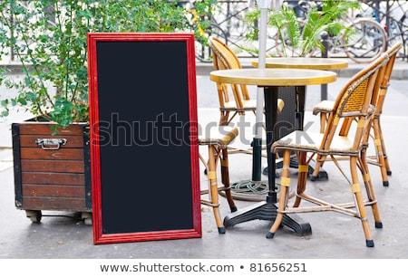 Paris vue sur la rue restaurants terrasse tableau noir fête Photo stock © ilolab