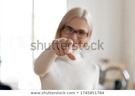 Businesswoman pointing at sign Stock photo © photography33