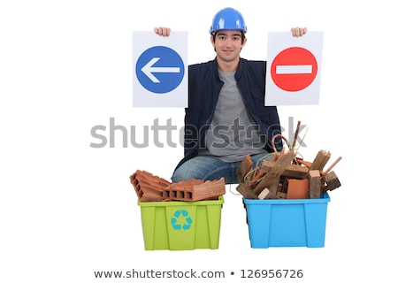 Worker kneeling by recycle boxes Stock photo © photography33