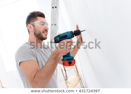 ремесленник рабочих дрель улыбка работу работник Сток-фото © photography33