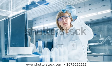 Young women conducting experiments Stock photo © photography33