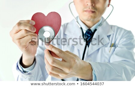 Doctor auscultating a patient against white background Stock photo © wavebreak_media