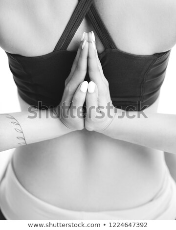 a young woman praying with her hands together on white backgroun stock photo © dacasdo