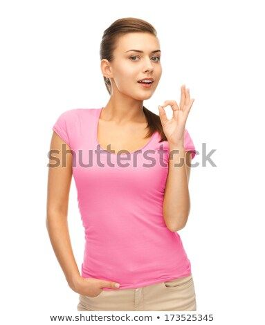 woman in blank color t-shirt showing ok gesture Stock photo © dolgachov