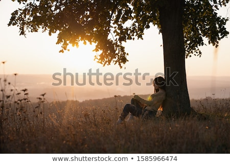 brunette woman sitting under the tree Stock photo © chesterf