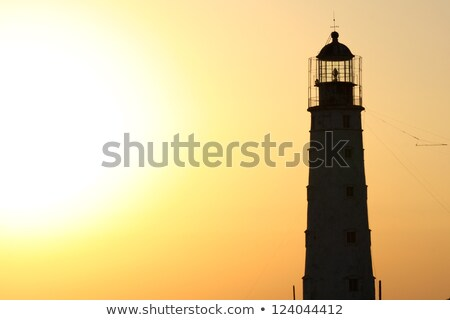 Phare silhouette or coucher du soleil mer lima Photo stock © pxhidalgo