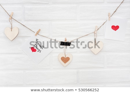 photos hanging on a clothesline on brick wall background Stock photo © REDPIXEL