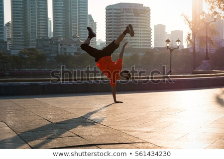 Hip hop, break dance performed by young man in city lights. Stock photo © photocreo