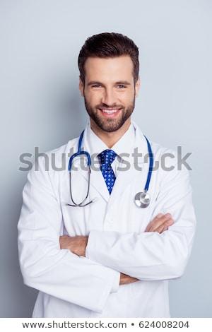 przystojny · mężczyzna · lekarz · odizolowany · biały · uśmiechnięty - zdjęcia stock © stockyimages