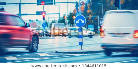 Stoplight on the road in the glow of the sunset. Stock photo © g215