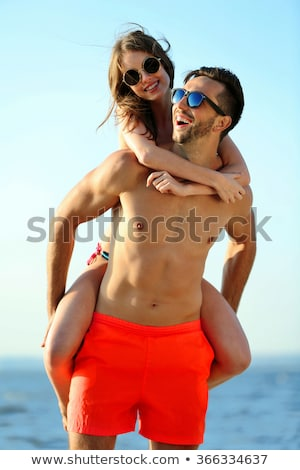 guy on the beach with sunglasses Stock photo © restyler