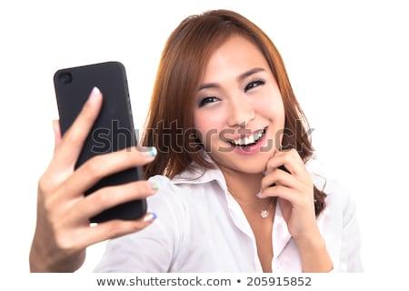Tienermeisje foto mobiele telefoon Stockfoto © vanTienen
