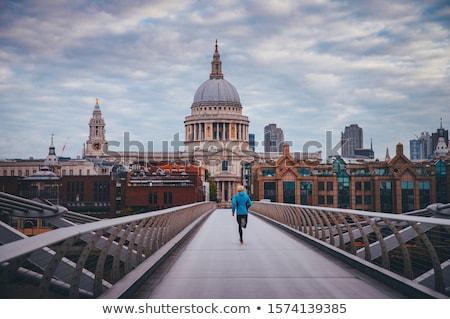 man running as sport in the city over bridge stock photo © kzenon