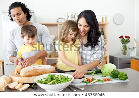 Stock photo: Positive family preparing lunch together