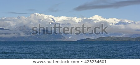White Capped Peaks Appearing Behind the Morning Clouds Stock photo © wildnerdpix