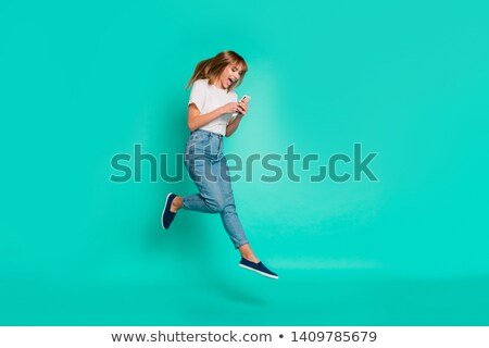surprised casual blonde woman texting on her smartphone Stock photo © feedough