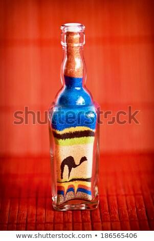 Flessen gekleurd zand woestijn kamelen Stockfoto © zurijeta