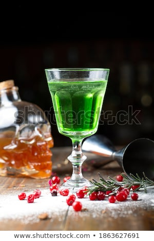 glass of absinthe with lime and sugar cubes stock photo © alex9500