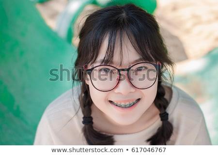 Nina tirantes riendo mirando Foto stock © sapegina