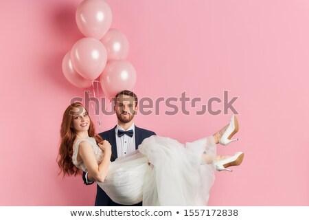 Menyasszony fehér esküvői ruha tart gyönyörű virágcsokor Stock fotó © dashapetrenko