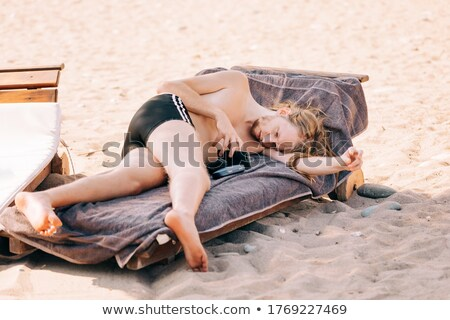 High angle view of shirtless man lying on towel at beach Stock photo © wavebreak_media