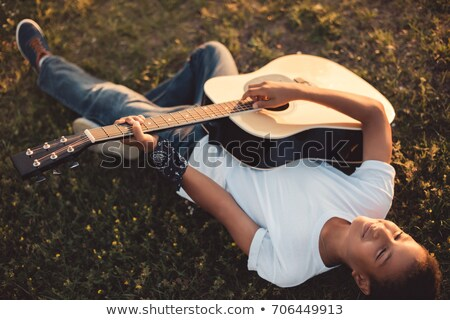 High angle view of boy playing guitar Stock photo © wavebreak_media