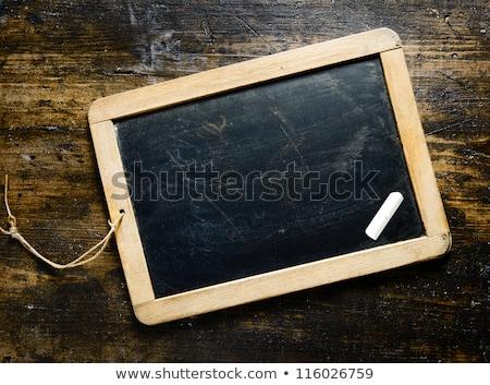 Blank slate and chalk on table Stock photo © wavebreak_media
