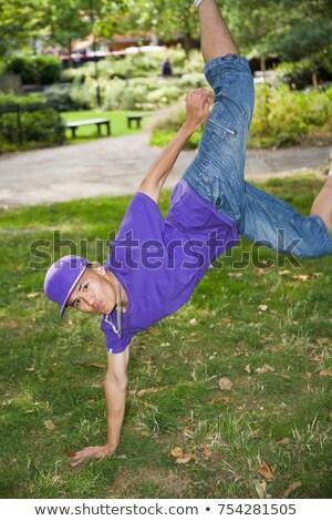 Hispanic Teenager street dancing in park Stock photo © IS2