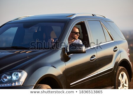man looks away with ray of light on his face  Stock photo © feedough