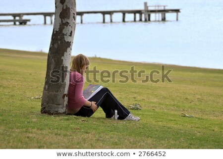 teenagers sitting against a tree stock photo © is2