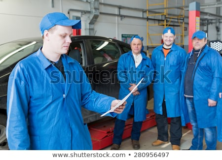 Group of workers and bosses in a garage. Stock photo © IS2