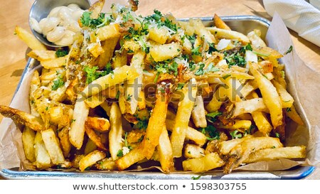tray of rustic golden french fries Stock photo © zkruger
