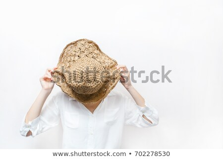 portrait of a happy young asian woman in straw hat stock photo © deandrobot