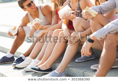 happy friends with takeout food outdoors Stock photo © dolgachov