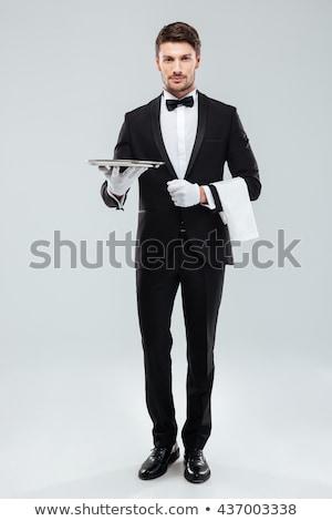 Gelukkig jonge De ober smoking Stockfoto © deandrobot
