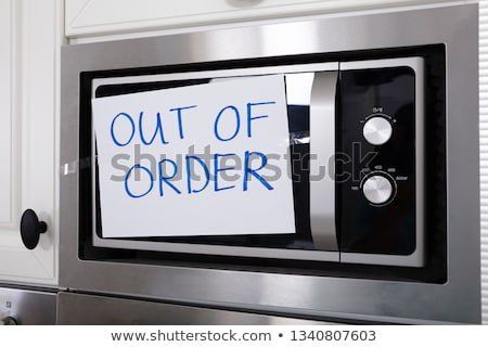 Stock photo: Out Of Order Text Stuck On Oven