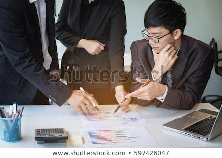 Iş ekibi bakıyor rapor tartışma ofis iş Stok fotoğraf © Freedomz