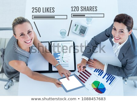 Women working on tablet with Likes and Shares status bars Stock photo © wavebreak_media