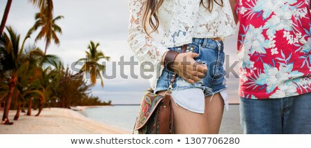 close up of hippie couple over tropical beach Stock photo © dolgachov