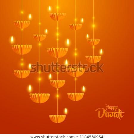 orange diwali festival card with hanging diya lamps stock photo © sarts