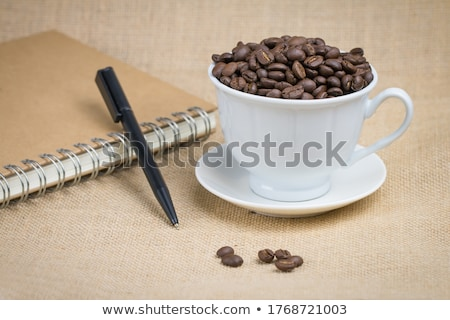A few books with cup of coffee on wooden floor Stock photo © przemekklos