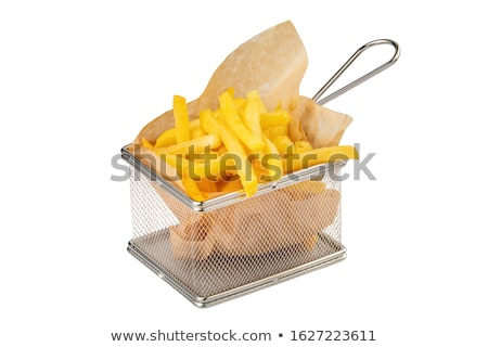 Delicious french fries in frying basket serving recipient on fir Stock photo © lightkeeper