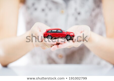 Woman Holding Model Car In Palm Of Hand Stock photo © HighwayStarz