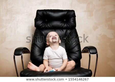 Erkek ofis koltuğu yalıtılmış siyah gülümseme telefon Stok fotoğraf © Lopolo