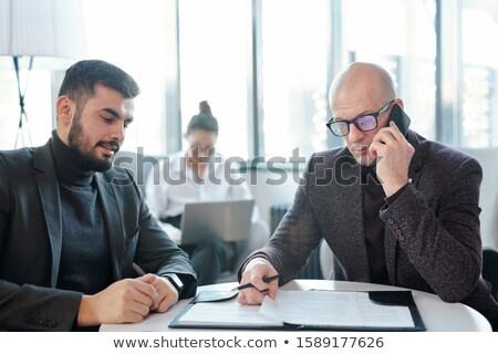 Ocupado corretor olhando documentos consultor cliente Foto stock © pressmaster